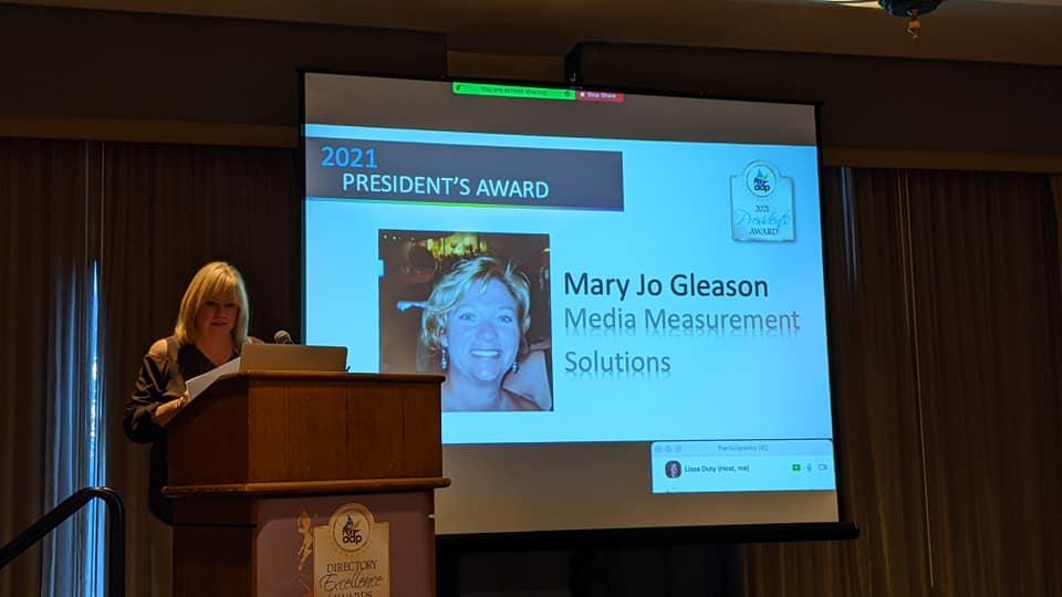 Cindi Aldrich, presenting the 2021 President's Award to Mary Jo Gleason